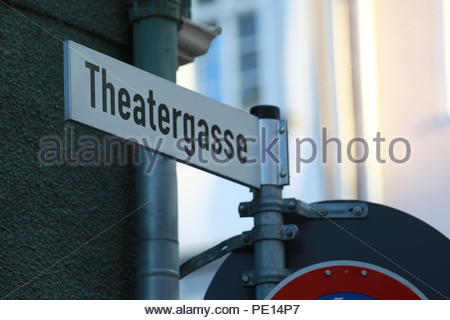 A sign in German indicating the name of a lane known as Theatergasse in   a town in Germany - Stock Photo