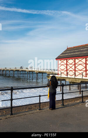 Woman looking out to sea at Saltburn pier, Saltburn-by-the-sea, North Yorkshire, England, - Stock Photo