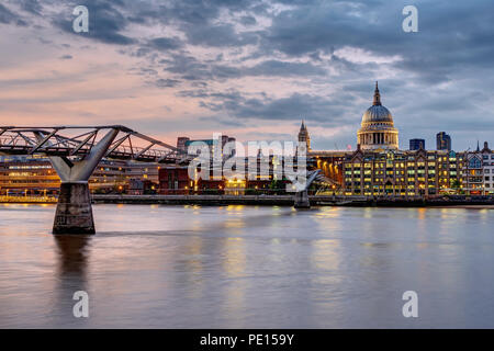 The Millennium Bridge and St. Paul's cathedral in London, UK, at sunset - Stock Photo
