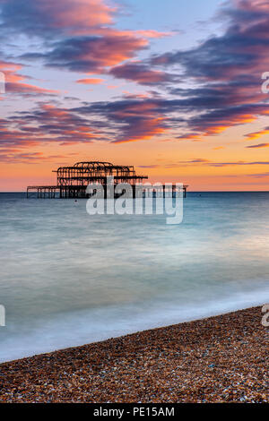 The ruin of the Brighton West Pier seen at sunset - Stock Photo