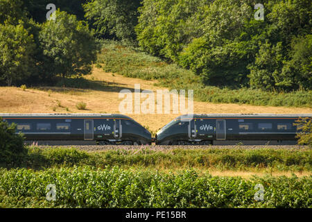 Middle of a new inter city express train operated by Great Western Railway at speed through countryside. The train is formed of two train units joined - Stock Photo