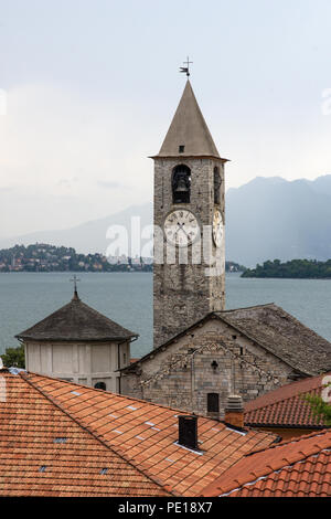 View from roof top terrace of Hotel Rosa Baveno Italy with view of church clock tower and Lago Maggiore - Stock Photo