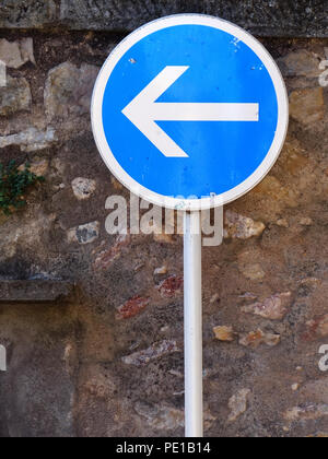 Turn left only street sign in Cessenon-sur-Orb, France - Stock Photo