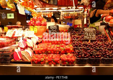 BARCELONA, SPAIN - JULY 13, 2018: fruits and vegetables stall in Barcelona Market (Mercat de Sant Josep de la Boqueria), a large public market - Stock Photo