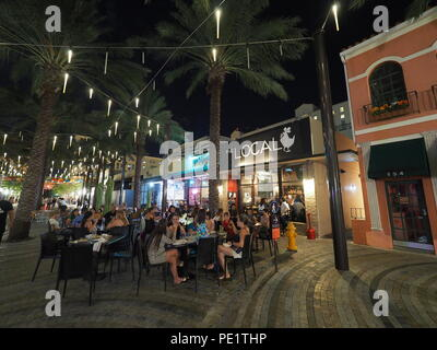 Giralda  Plaza and its restaurants and bars in Coral Gables, Florida, at night, enjoying heavy visitation during the Umbrella Sky project. - Stock Photo