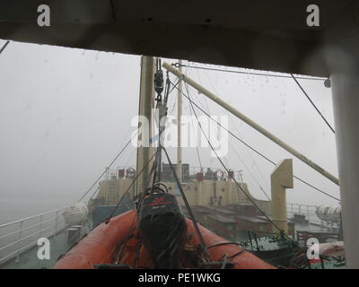 Close up of the decks of the SS Shieldhall on a lunchtime cruise in Southampton Waters; it's very wet and grey, sea and sky are indistinguishable - Stock Photo
