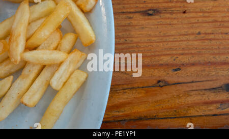 Top Angle View of Home Made French Fries on White Plate - Stock Photo