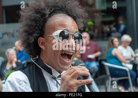 Glasgow, Scotland, UK. 11th August, 2018. A performer in the Merchant City Festival which is being run in conjunction with Festival 2018. Festival 2018 is the cultural programme of the Glasgow 2018 European Championships. Credit: Skully/Alamy Live News - Stock Photo