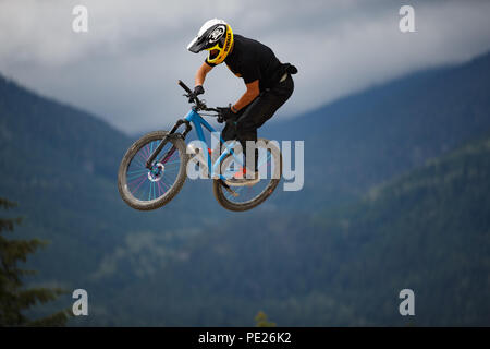 Whistler, BC, Canada. August 11, 2018. Daryl Brown (GBR) performs an aerial at the 2018 Clif Dual Speed and Style presented by Muc-Off race at the Crankworx Whistler mountain bike festival. Credit: Ironstring/Alamy Live News - Stock Photo