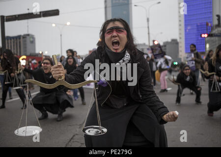 Lima, Peru. 11th Aug, 2018. A demonstrator shout slogans during a Ni Una Menos (Not One Less) rally in protest of gender based violence in Lima. Ni Una Menos (Not One Less) demands that women should be protected from violent deaths at the hands of men in Peru. Credit: Guillermo Gutierrez/SOPA Images/ZUMA Wire/Alamy Live News - Stock Photo