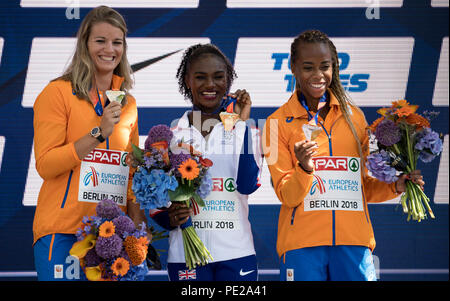 Berlin, Germany. 12th Aug, 2018. Track and Field, European Championship, Award Ceremony on the European Mile at Breitscheidplatz, 200m, Women: Silver medallist Dafne Schippers (l-r) from the Netherlands, gold medallist Diana Asher-Smith from Great Britain and bronze medallist Jamile Samuel from the Netherlands. Credit: Sven Hoppe/dpa/Alamy Live News - Stock Photo
