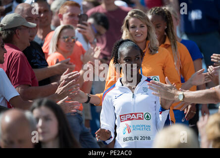 Berlin, Germany. 12th Aug, 2018. Track and Field, European Championship, Award Ceremony on the European Mile at Breitscheidplatz, 200m, Women: Gold medallist Dina Asher-Smith from Great Britain, silver medallist Dafne Schippers from the Netherlands and bronze medallist Jamile Samuel from the Netherlands attend the award ceremony. Credit: Sven Hoppe/dpa/Alamy Live News - Stock Photo
