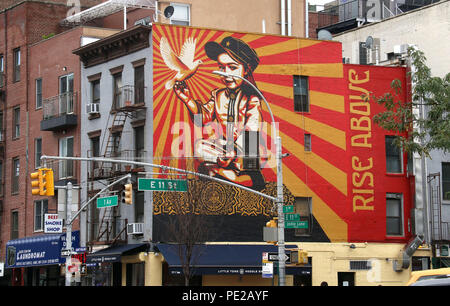 New York City, New York, USA. 12th Aug, 2018. A view of the 'Rise Above' mural by artist SHEPARD FAIREY located on East 11th Street and 1st Avenue in the East Village. The model was his eldest daughter at the age of 3 years. The artist is best known for his Obama 'Hope' poster. The project is meant to be uplifting and make kids and New Yorkers hopeful and happy. Credit: Nancy Kaszerman/ZUMA Wire/Alamy Live News - Stock Photo