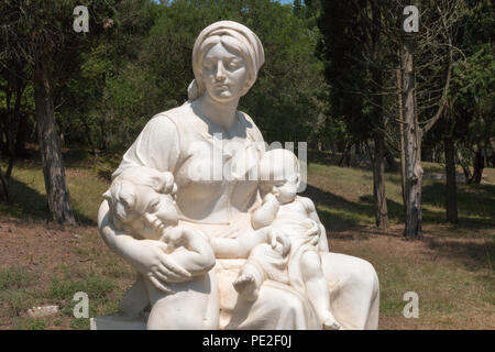 Brijuni, Croatia - July 28, 2018: View of the white statue of a woman with two children on the island of Veli Brijuni in the Brijuni Islands National  - Stock Photo