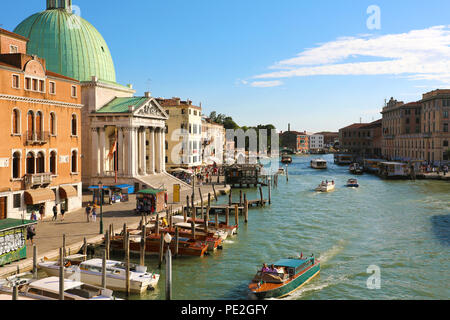 VENICE, ITALY - JUNE 18, 2018: beautiful sunset on Venice with the Grand Canal and the green dome of the church San Simeon Piccolo, Venice, Italy - Stock Photo