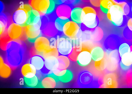 christmas and new year concept - Defocused abstract multicolored bokeh lights background. Blue, purple, green, orange colors. - Stock Photo