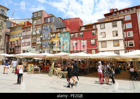 PORTO, PORTUGAL - JUNE 21, 2018: colorful houses and restaurantes along the river Douro, Porto City, Portugal - Stock Photo