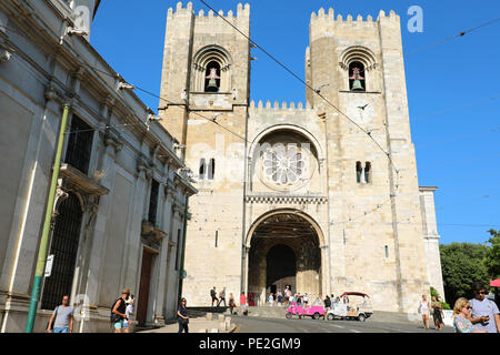 LISBON, PORTUGAL - JUNE 25, 2018: Lisbon Cathedral with tourists walking in the street, Portugal - Stock Photo