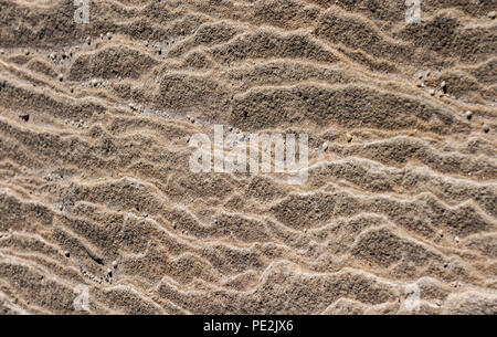 Wind eroded sandstone rock face with wavy pattern ideal for natural textured background - Stock Photo