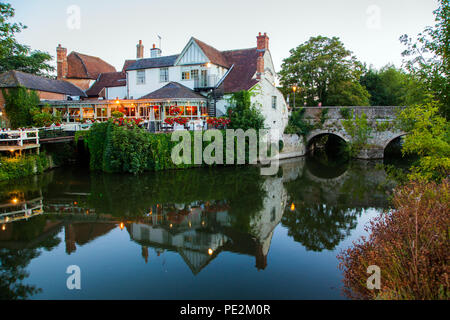 The Nags Head pub on the bridge over Nags head island in the river Thames at Abingdon  on Thames Oxfordshire floodlit  in the evening light - Stock Photo