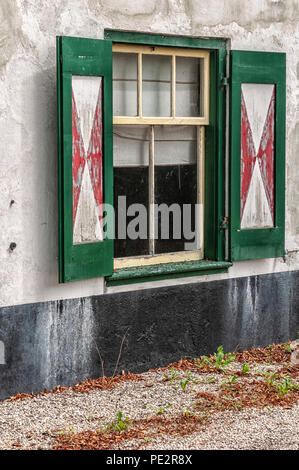 old Dutch window shutters of an old dilapidated building - Stock Photo