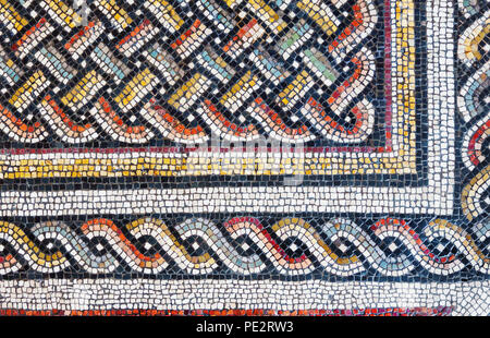 Colorful small tiles of an ancient floor mosaic, geometric ornament background - Stock Photo