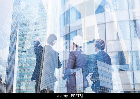 group of business people discussing real estate project, construction of new building, cooperation of architect, designer and manager - Stock Photo
