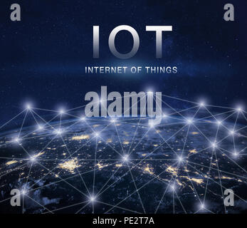IOT, internet of things concept with global network around earth - Stock Photo