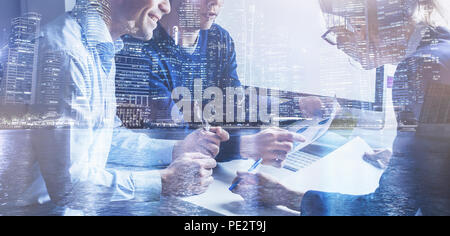 business team of coworkers working on startup in office, banner double exposure background of group of businessman people entrepreneurs - Stock Photo