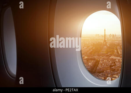 travel to Paris, view of Eiffel Tower from the window of airplane, holidays in France, Europe - Stock Photo