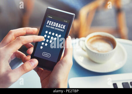 positive feedback, customer satisfaction concept, woman rating service online and writing review on smartphone - Stock Photo
