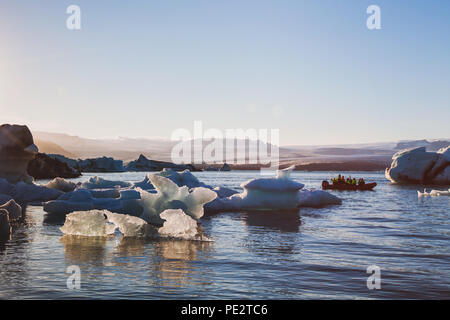 tourist boat in Jokulsarlon glacier lagoon, travel to Iceland - Stock Photo