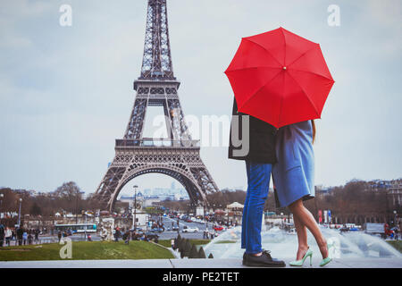 romantic holidays for couple in Paris, honeymoon vacation in France, Europe, man and woman kissing near Eiffel tower - Stock Photo