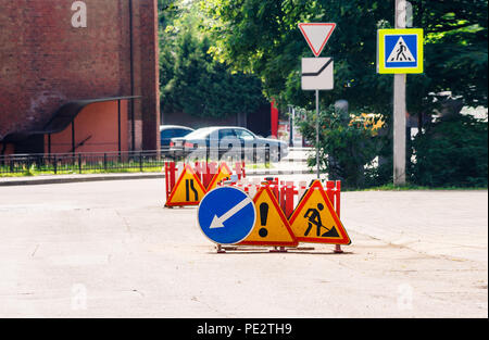 road sign road repair on a closed road section in the city on sunny summer day - Stock Photo