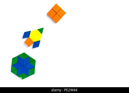 A child plays with colored blocks constructs a model on a
