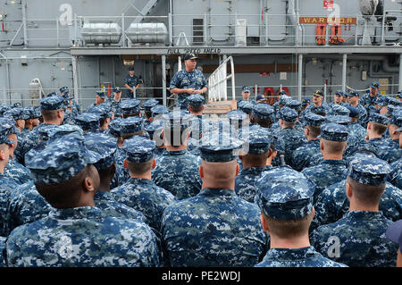 150925-N-NZ935-069   SASEBO, Japan (Sept. 25, 2015) Rear Adm. John Nowell Jr., commander Expeditionary Strike Group (ESG) 7, holds an all-hands call for mine countermeasures ships USS Pioneer (MCM 9), USS Warrior (MCM 10) and USS Chief (MCM 14). Rear Adm. Nowell is in the middle of a weeklong visit to Sasebo where he is visiting some of the commands that fall under ESG 7. (U.S. Navy photo by Mass Communication Specialist 1st class Joshua Hammond/Released) - Stock Photo