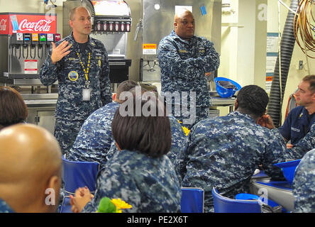 NEWPORT NEWS, Va. (Sept. 21, 2015) -- Pre-commissioning Unit Gerald R. Ford (CVN 78) Command Master Chief Donald Novak speaks with Ford's First Class Petty Officers' Association on the mess decks. (U.S. Navy photo by Mass Communication Specialist 2nd Class Cory Rose/Released) - Stock Photo
