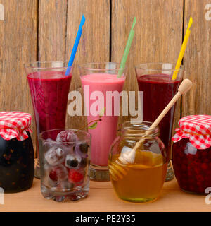 Set of berry smoothies, jams and frozen berries - Stock Photo