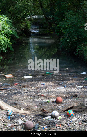 River pollution collected near a pollution grate,River Brent, near Brent Reservoir, also known as Welsh Harp Reservoir, Brent, London, United Kingdom - Stock Photo