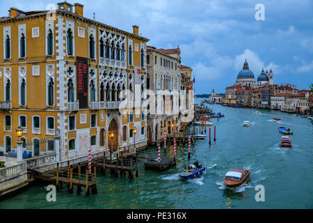 Venice, Italy - September 24, 2017: Sunset at the iconic 17th-century Santa Maria di Salute Basilica, view from Academia bridge or Puente de la academ - Stock Photo