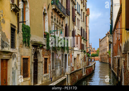 Typical view of a weathered building facade on a picturesque canal in Venice, Italy - Stock Photo