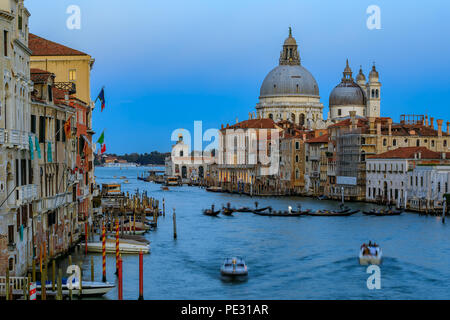 Sunset at the iconic 17th-century Santa Maria di Salute Basilica, view from Academia bridge or Puente de la academia along the Grand Canal in Venice,  - Stock Photo