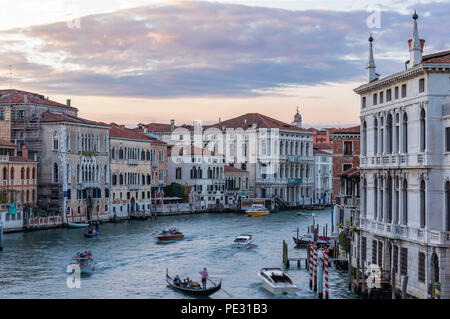 Sunset at the Academia bridge or Puente de la academia along the Grand Canal in Venice, Italy - Stock Photo