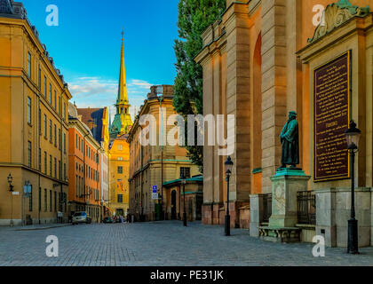 Stockholm, Sweden - August 11, 2017: View onto traditional gothic buildings and the gates of Storkyrkan or Stockholm Cathedral in the old town, Gamla  - Stock Photo