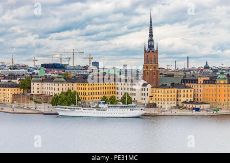 Stockholm, Sweden - August 10, 2017:  View onto Riddarholmen island and Riddarholmen church, the burial church of Swedish monarchs, in old town Gamla  - Stock Photo