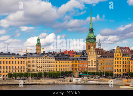 Stockholm, Sweden - August 10, 2017:  Traditional gothic buildings on Kornhamnstorg square, Harbour Square, in the old town, Gamla Stan - Stock Photo