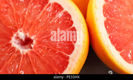 Closeup detail of pink grapefruit cut in half - Stock Photo