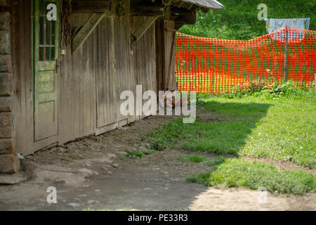 Traditional old wooden barn in the highlands of the Carpathians. A place for livestock. - Stock Photo