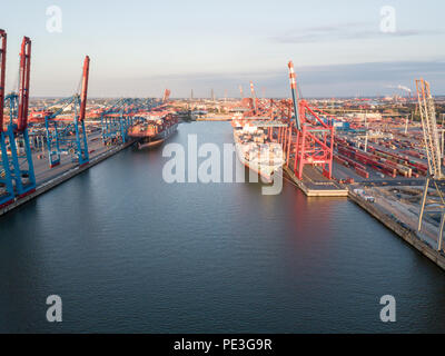 Container ships in port of Hamburg - Stock Photo