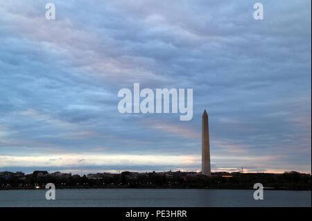 One of the most notable landmarks found in the nation's capital is the Washington Monument, viewed here from across the Tidal Basin on a late evening - Stock Photo